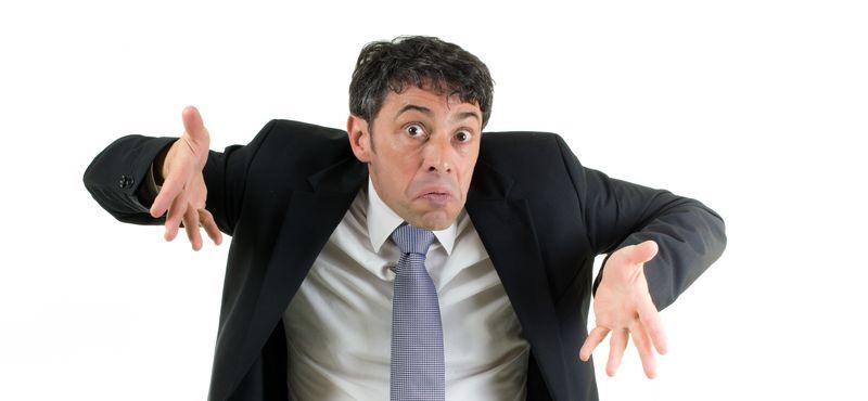 Man shrugging his shoulders in ignorance
